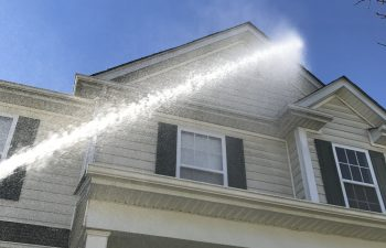 House Exterior Being Pressure Washed
