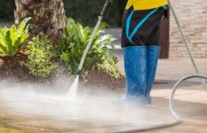 Person Pressure Washing a Driveway in Sherrills Ford NC
